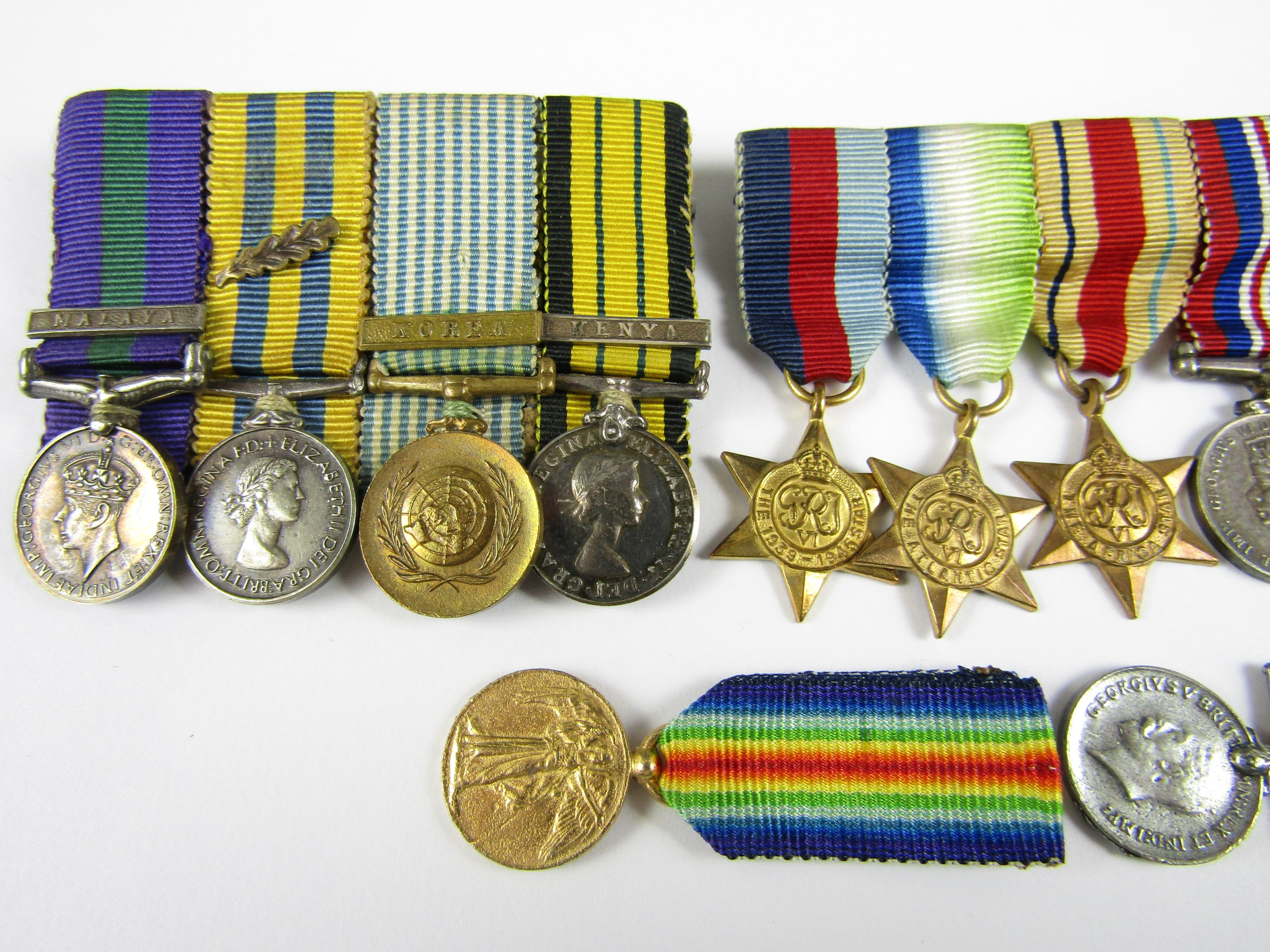 Lot 46 - Four various Great War and later miniature medal groups