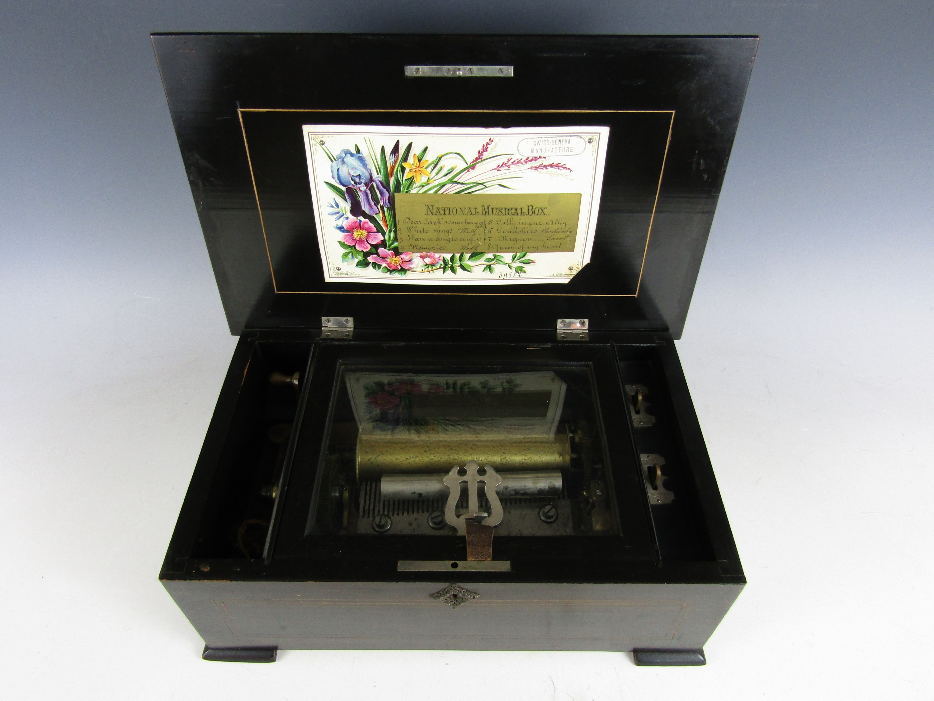 Lot 29 - A Victorian Swiss made National Music Box, playing eight airs, in a scumbled wooden case with string