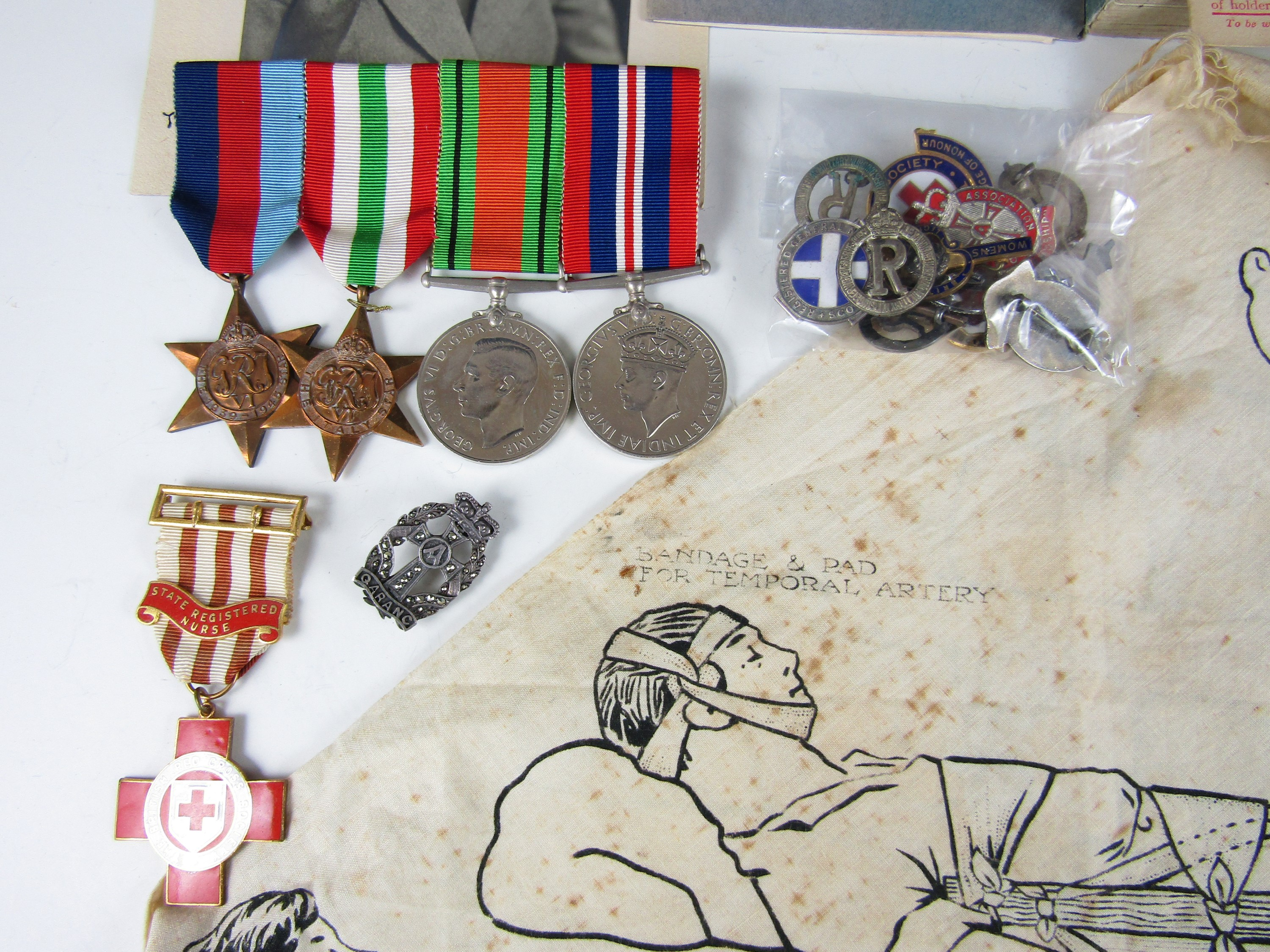 Lot 50 - A Second World War and later military and civil nursing group, comprising medals, insignia and