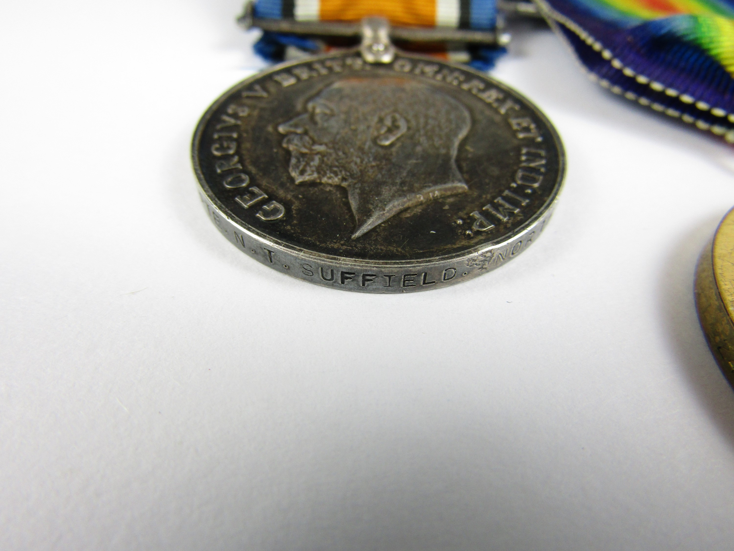 Lot 48 - A British War and Victory medal pair to 242807 Pte N T Suffield, Northumberland Fusiliers