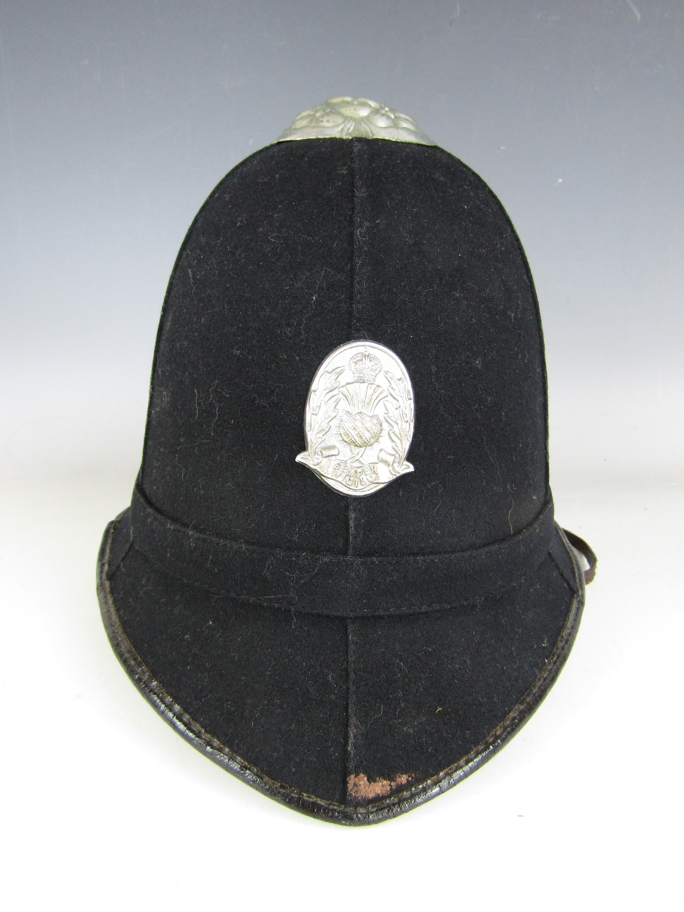 Lot 12 - A Scottish Police cork helmet by Millar of Dundee, second quarter 20th Century