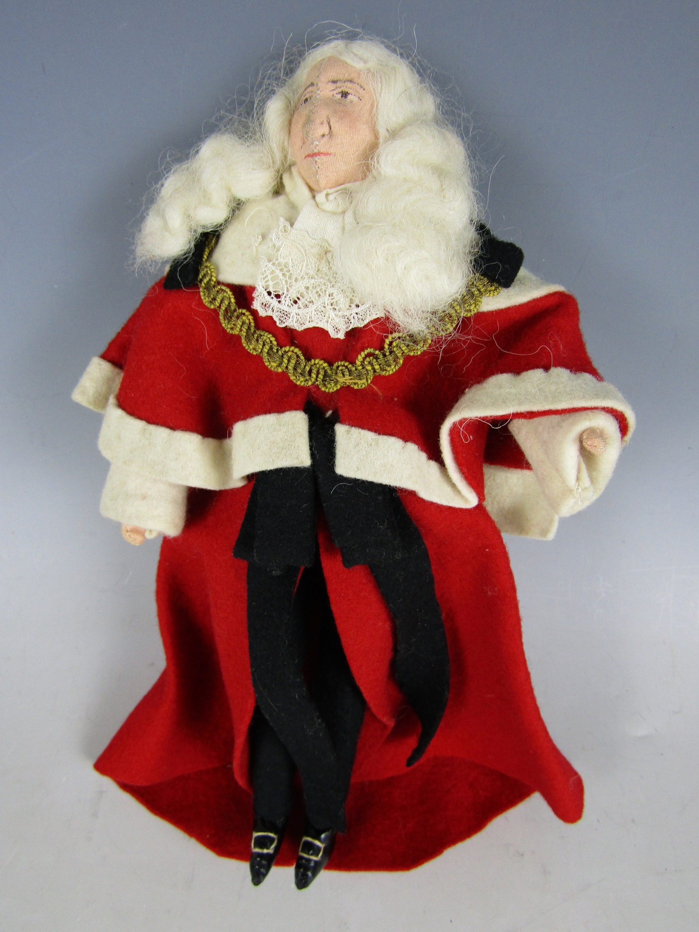 Lot 36 - A late 1930s Kimport Doll of a judge, hand constructed in cloth and dressed in conforming felt