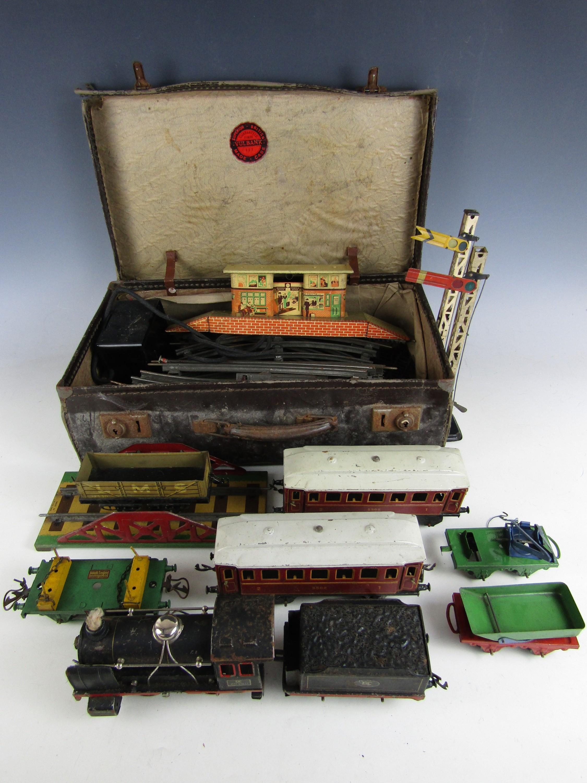 Lot 39 - [Model Railway] A vintage German 0-gauge 0-4-0 DC 20-volt locomotive and tender, together with