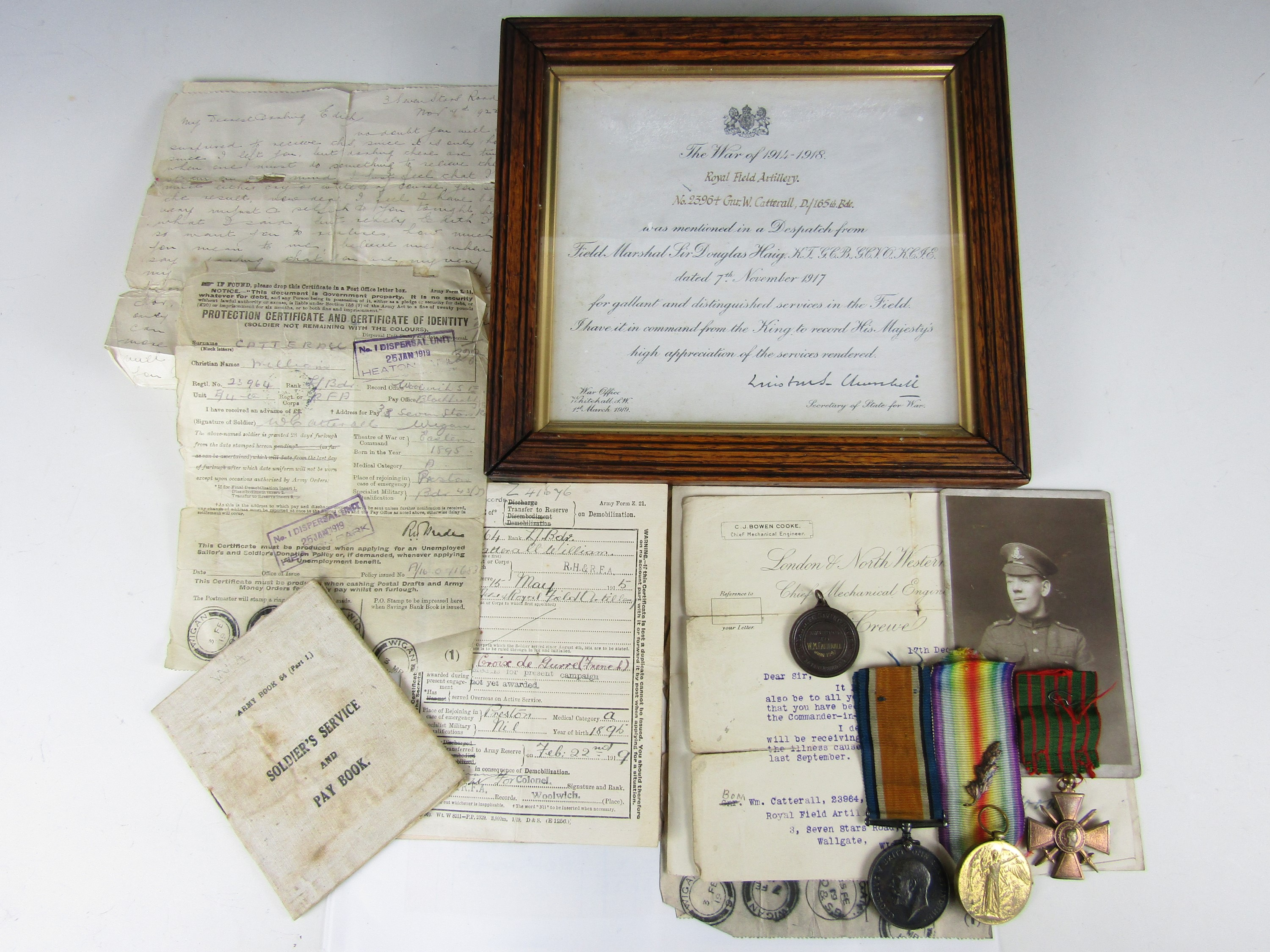 Lot 57 - A British War and Victory medal pair to L-23964 Gunner W Catterall, the latter medal's ribbon
