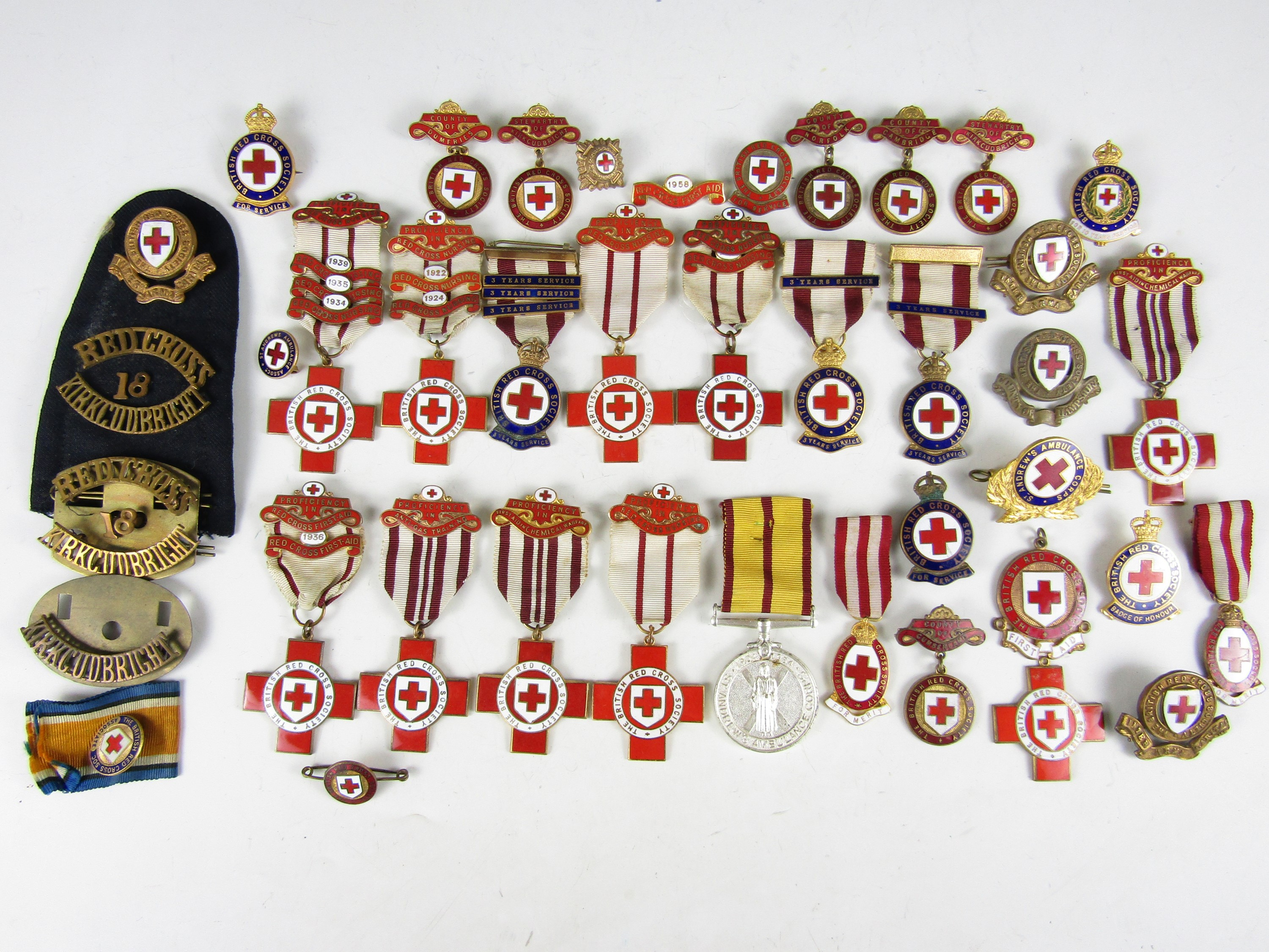 Lot 59 - A large quantity of Red Cross and similar medals and insignia
