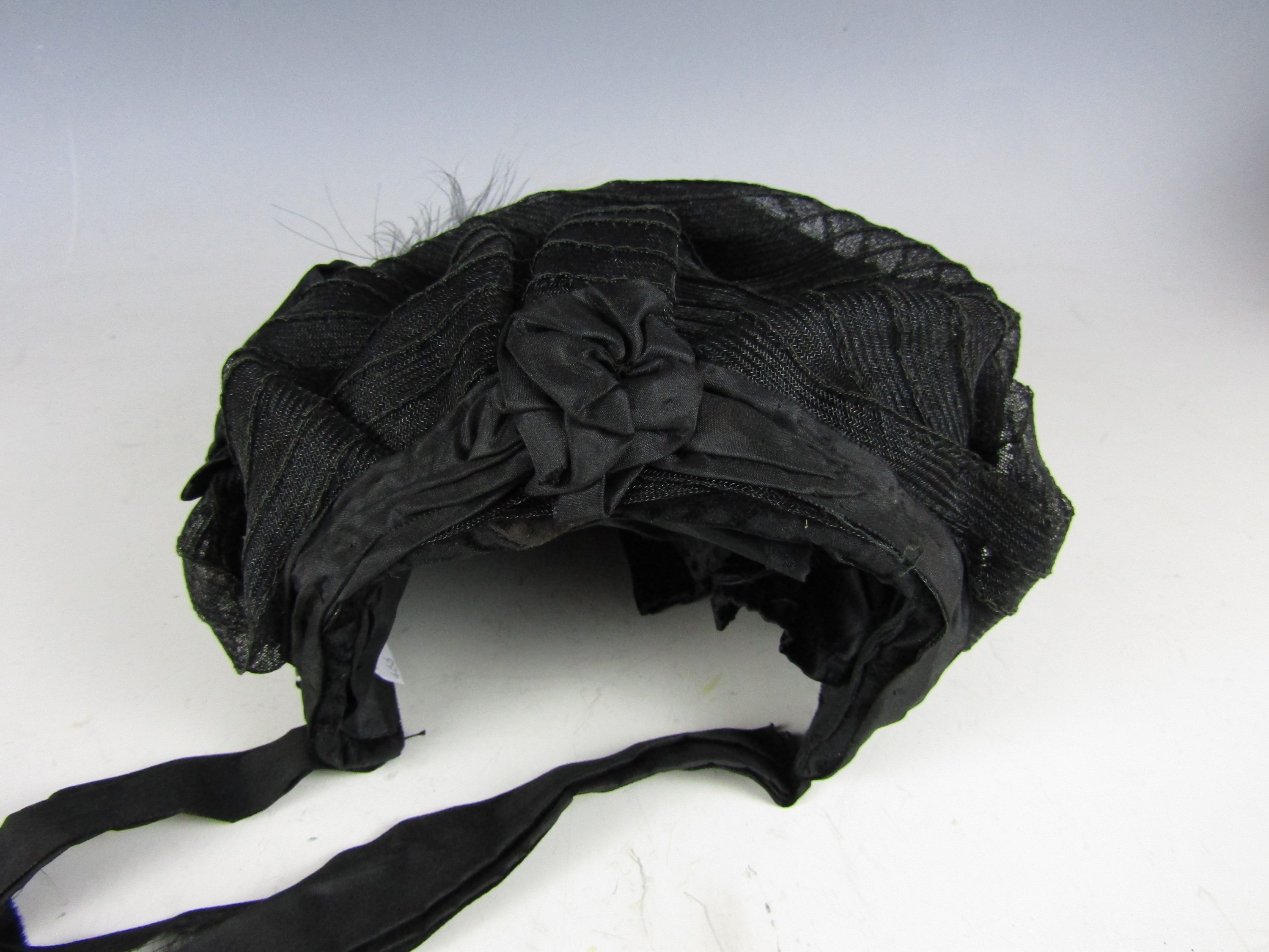 Lot 41 - A late Victorian lady's black mesh bonnet, decorated with sequins, pink velvet flowers and black