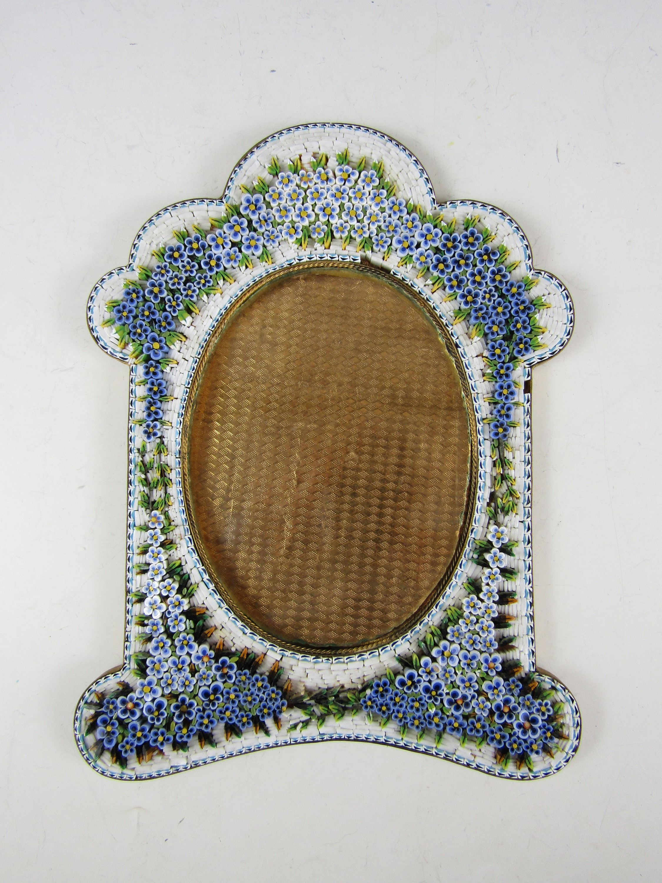 Lot 11 - Two late 19th Century Venetian glass micromosaic picture frames, one in the shape of a heart with