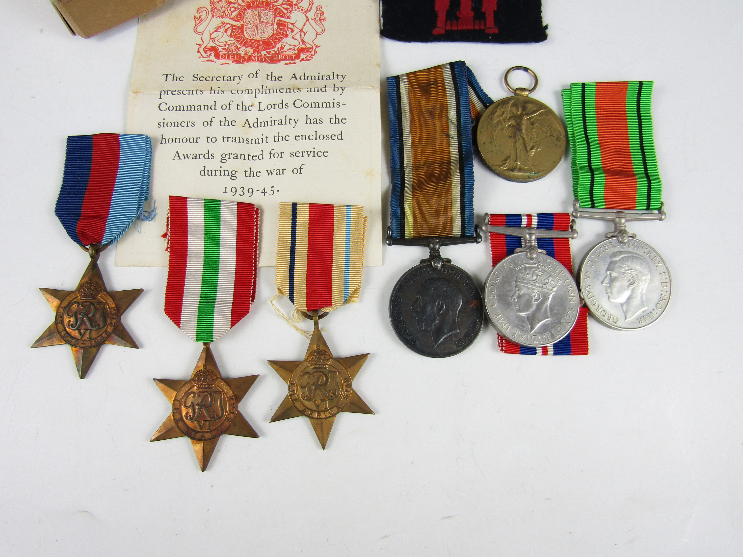 Lot 49 - A British War and Victory medal to J 68078 AB H Morris, Royal Navy, together with a group of