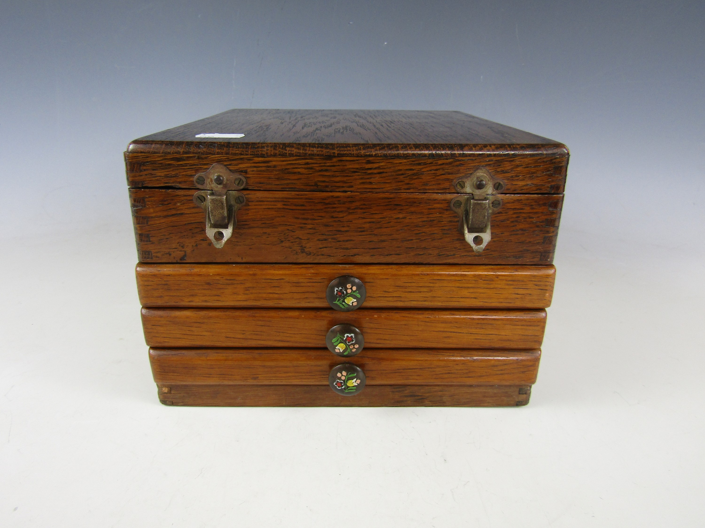 Lot 8 - A 1930s oak cased Mah-jong set, with composition tiles, bone markers and dice, 22 x 25 x 15 cm high