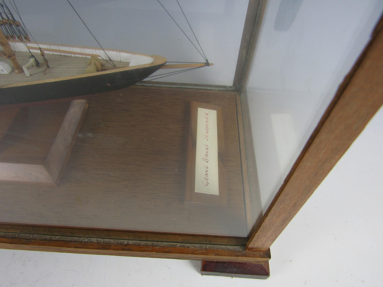 Lot 10 - [Model boats / ships] A fine hand-built scale model of a Grand Banks Schooner, in glazed oak case,