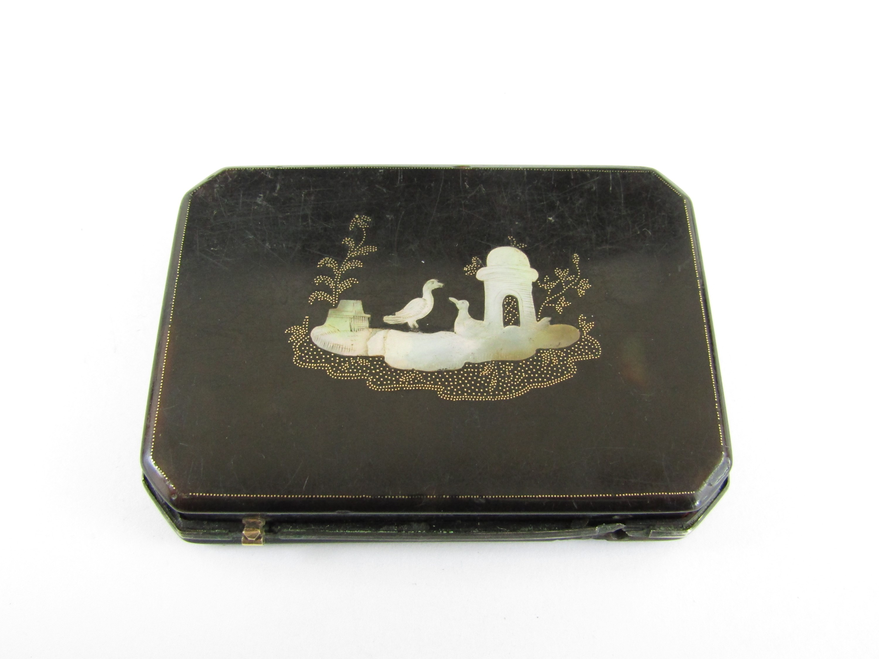 Lot 7 - An early 18th Century tortoiseshell snuff box, rectangular with canted corners, the hinged lid