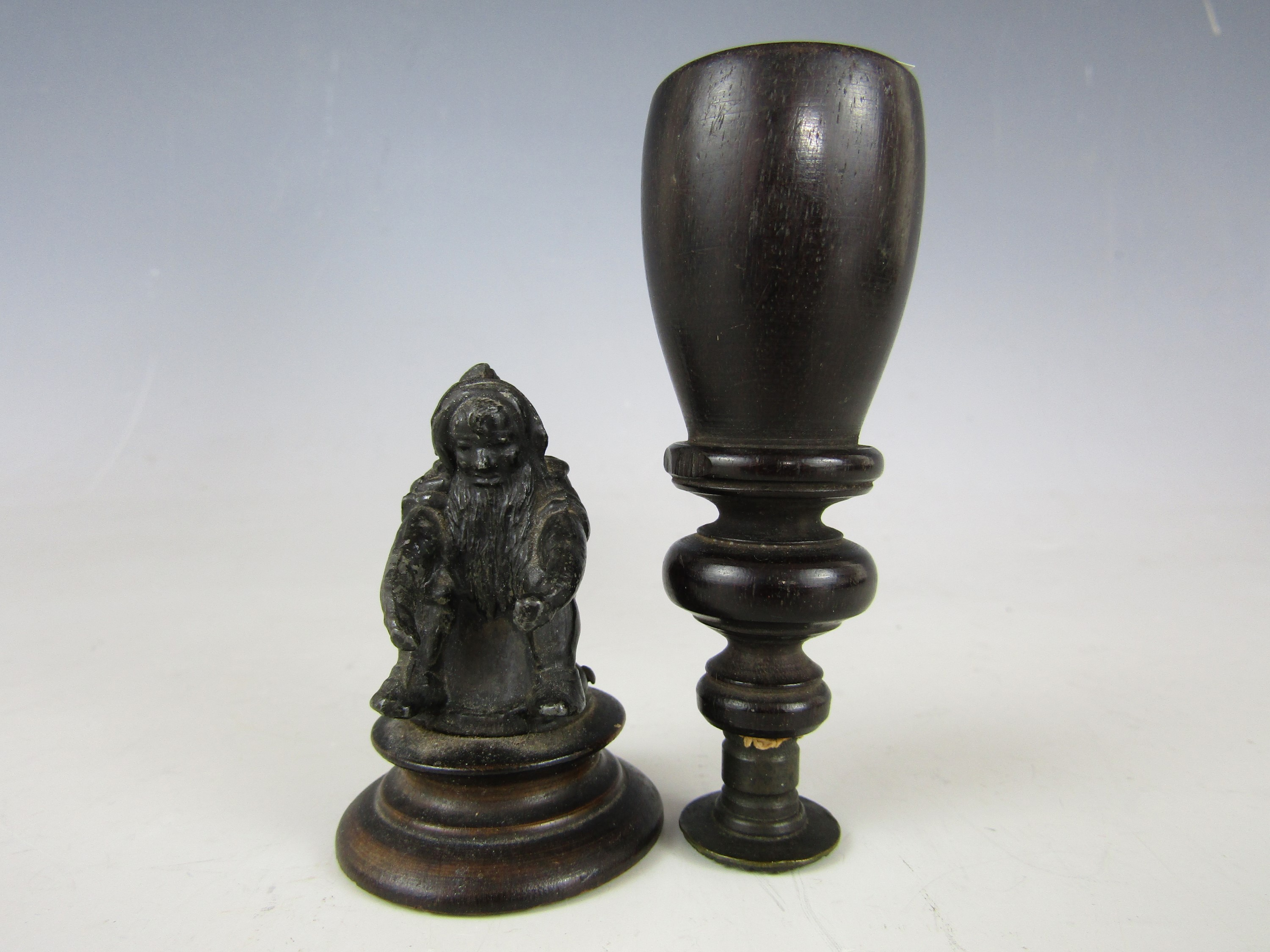 Lot 23 - A 19th Century desk seal with turned ebony handle and chequered matrix, together with a small