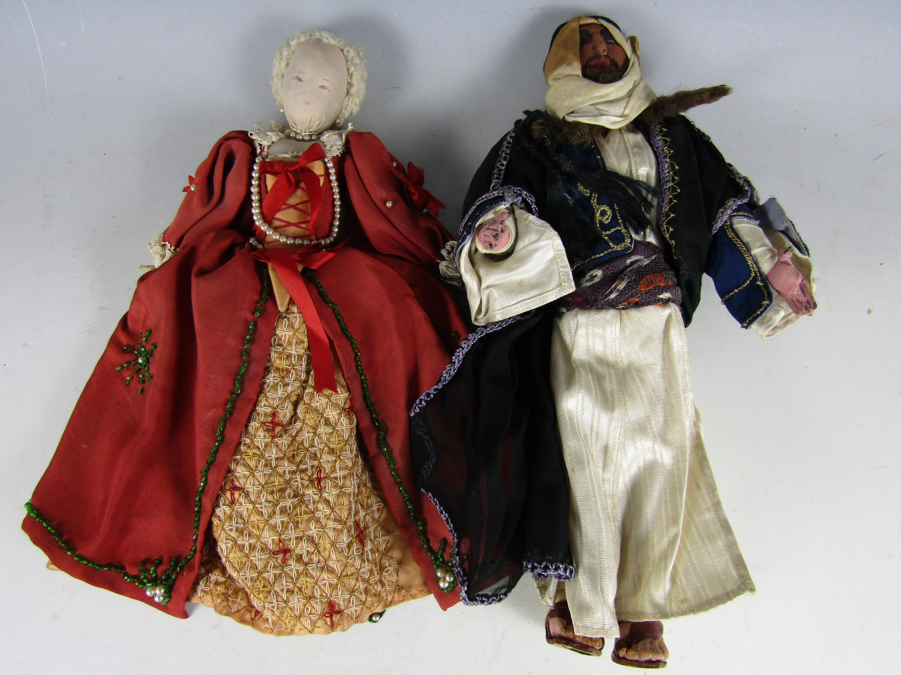 Lot 37 - Two vintage hand constructed cloth dolls, one modelled as an Arabian prince, of cotton covered