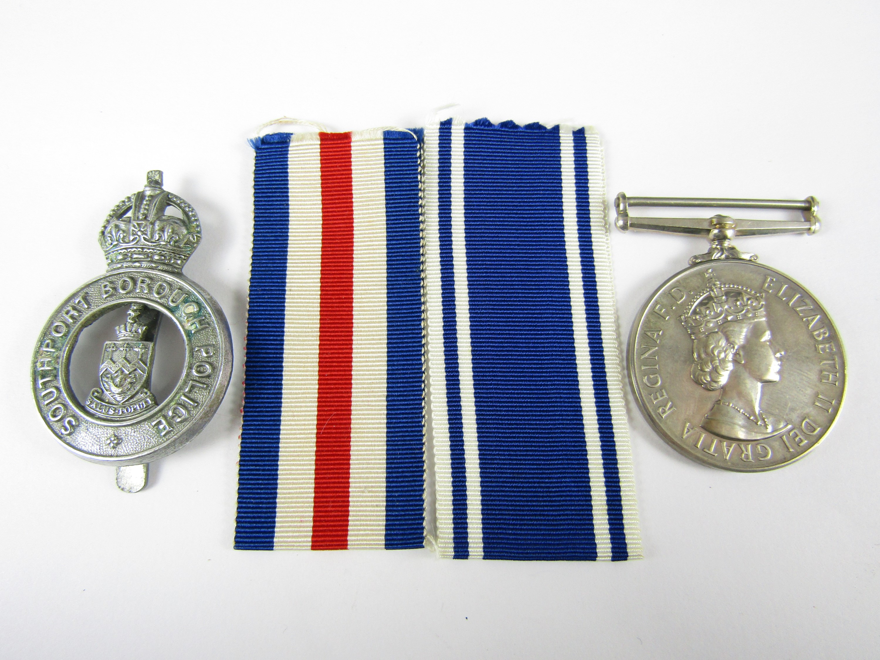 Lot 56 - A Queen Elizabeth II Police Long Service and Good Conduct medal to Constable Wilfrid C Arnold,