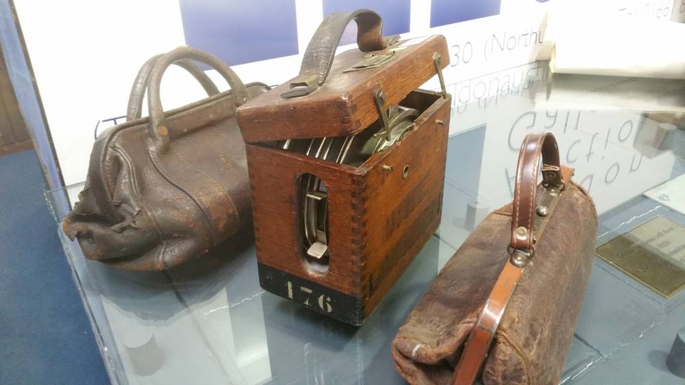 Lot 6 - A Pigeon Clock and two bags