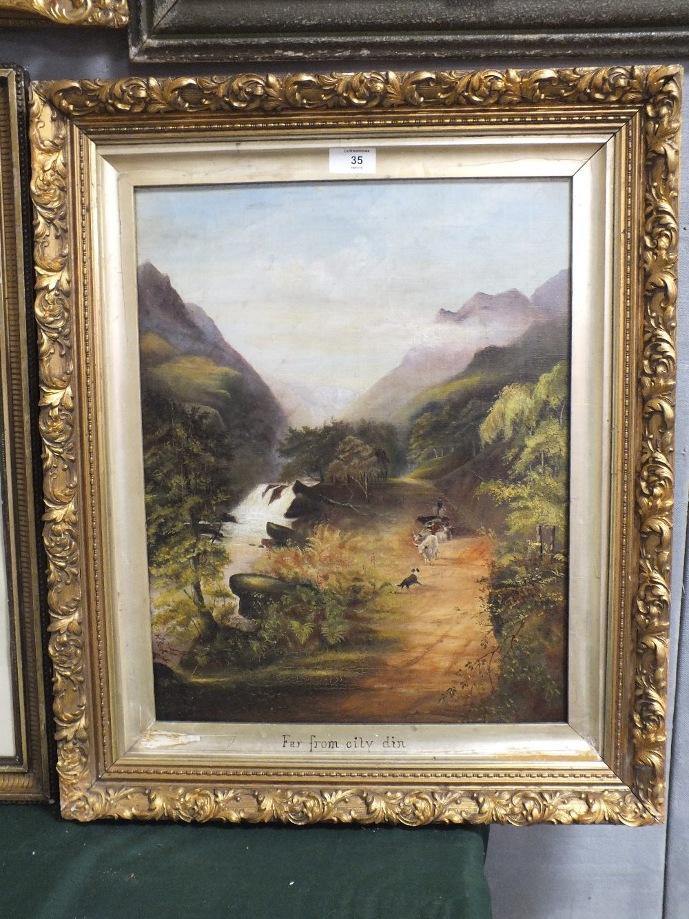 Lot 35 - A GILT FRAMED OIL ON CANVAS DEPICTING A MOUNTAINOUS RIVER SCENE WITH CATTLE ENTITLED 'FAR FROM