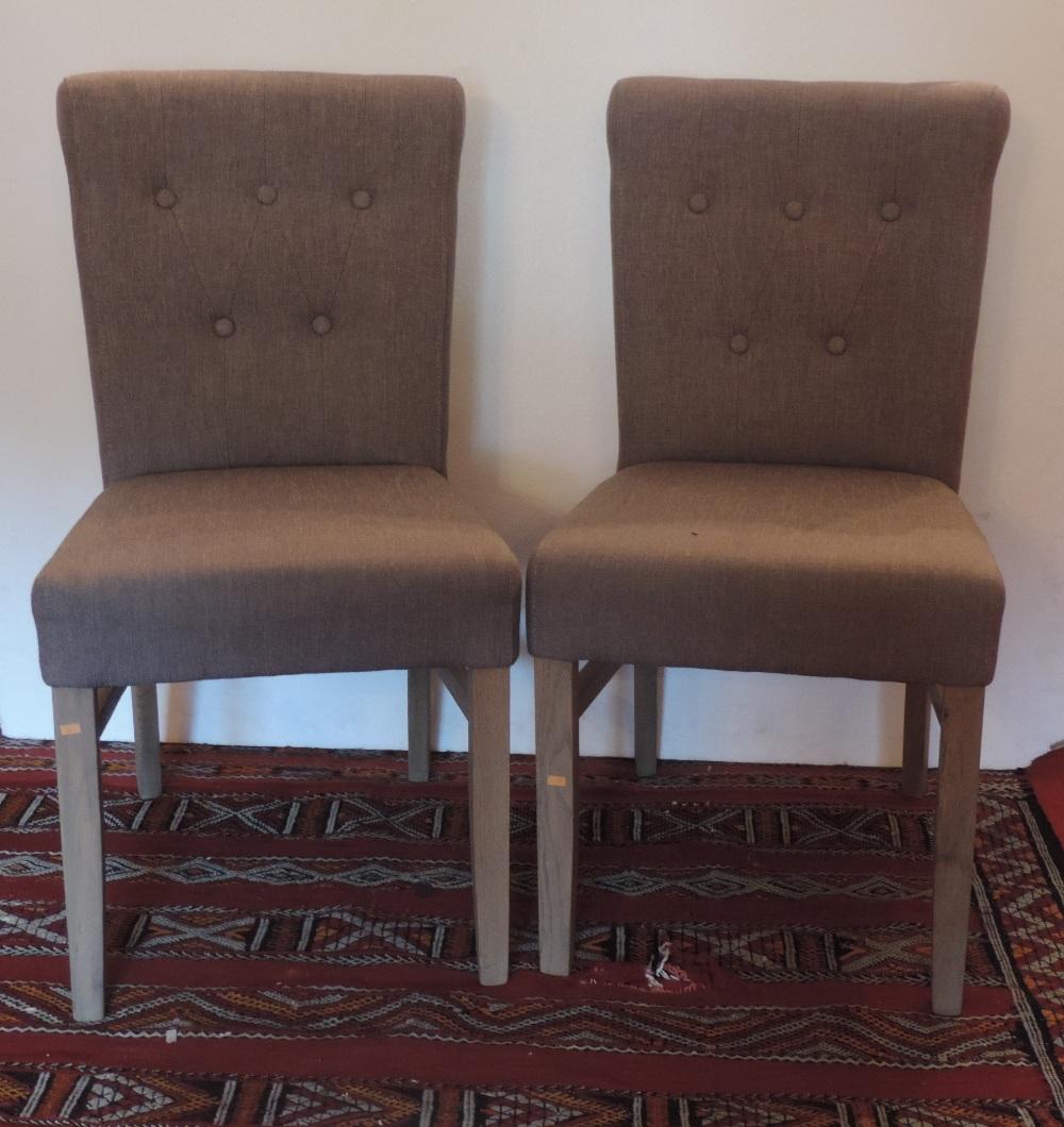 Lot 15 - A set of four modern upholstered beech S