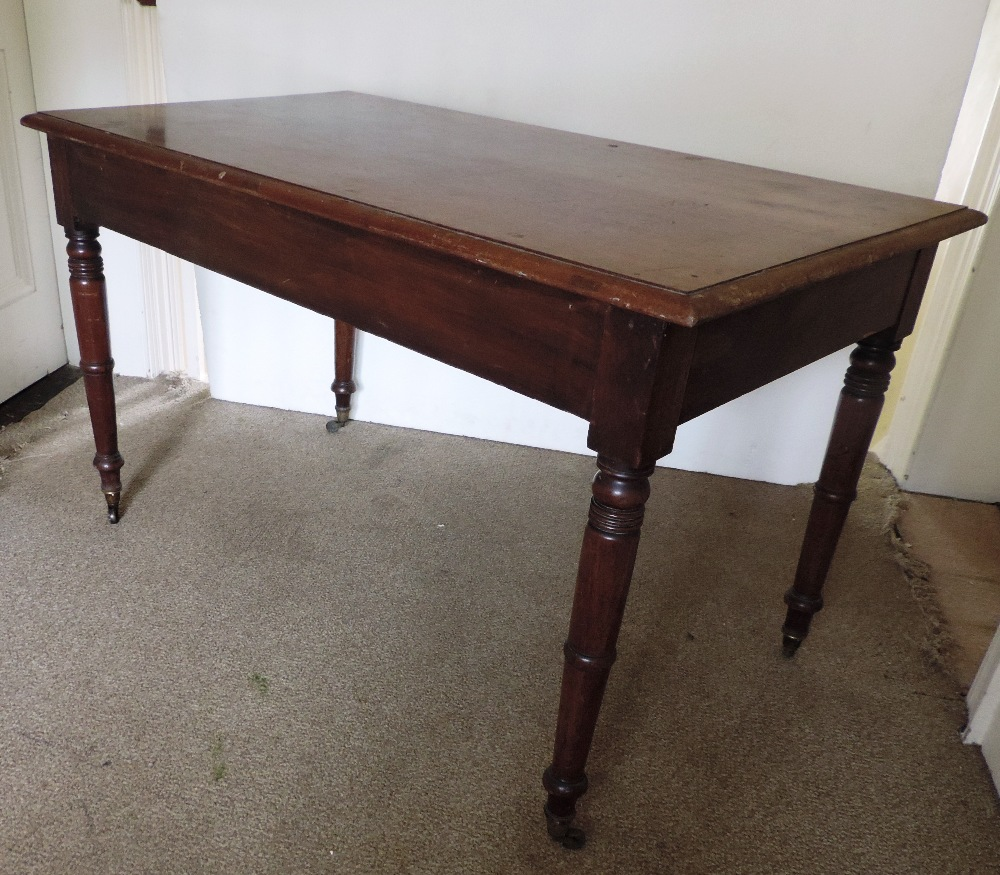 Lot 26 - A mahogany Occasional Table, on four tur