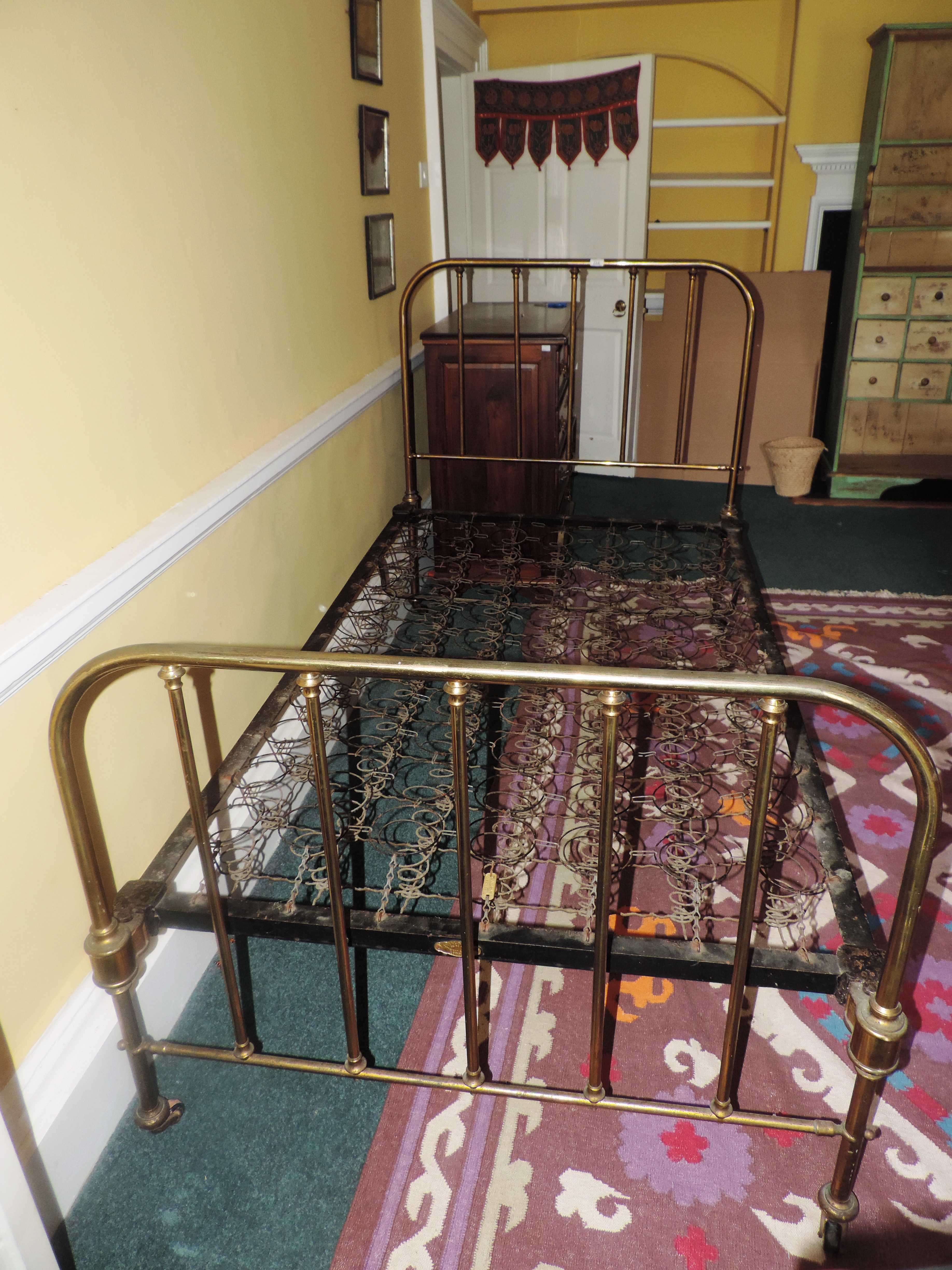 Lot 22A - An attractive single Bed, with brass bra