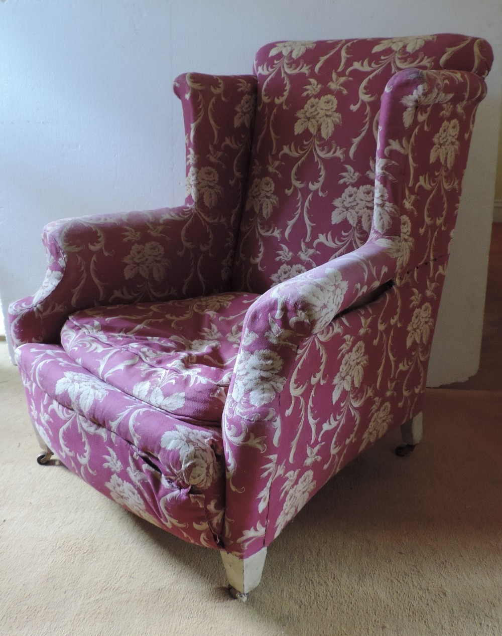A 19th Century upholstered wing back Arm