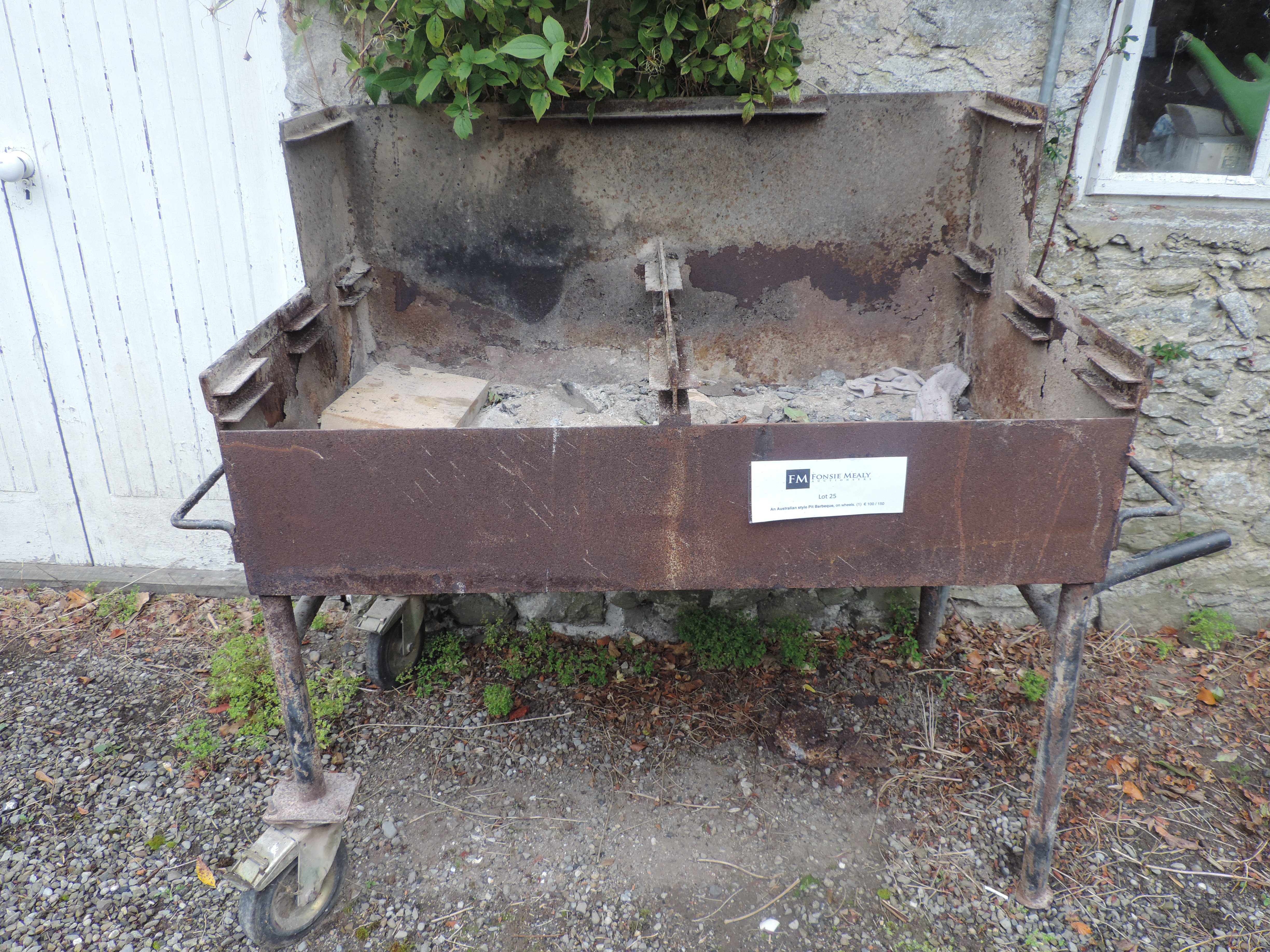 Lot 25 - An Australian style Pit Barbeque,  on wh