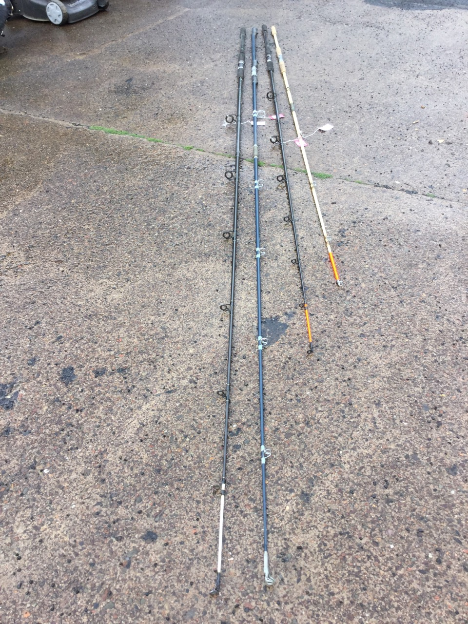 Lot 681 - Three long beachcasting rods; and a fibreglass sea fishing rod. (4)