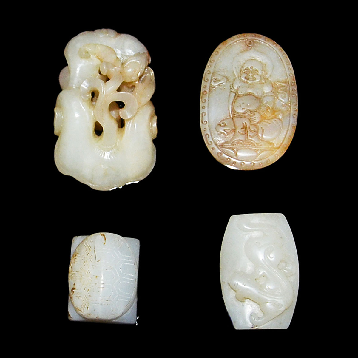 Lot 12 - 玉雕把玩項飾一組四件 A Group of Four Jade Pebble and Pendant Carvings. Length: 1⅛ - 2¼ in (2.9 - 5.7 cm)