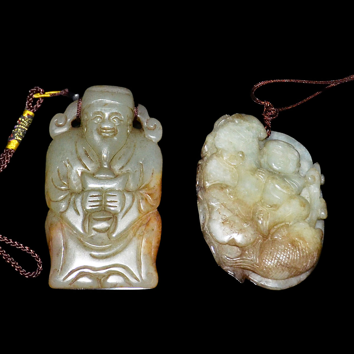 Lot 38 - 玉雕人物把玩一組二件:老子,荷塘嬰戲鲤魚 Two Carved Jade Pebbles: Scholar with Tablet and Lotus Pond Child with Carp.