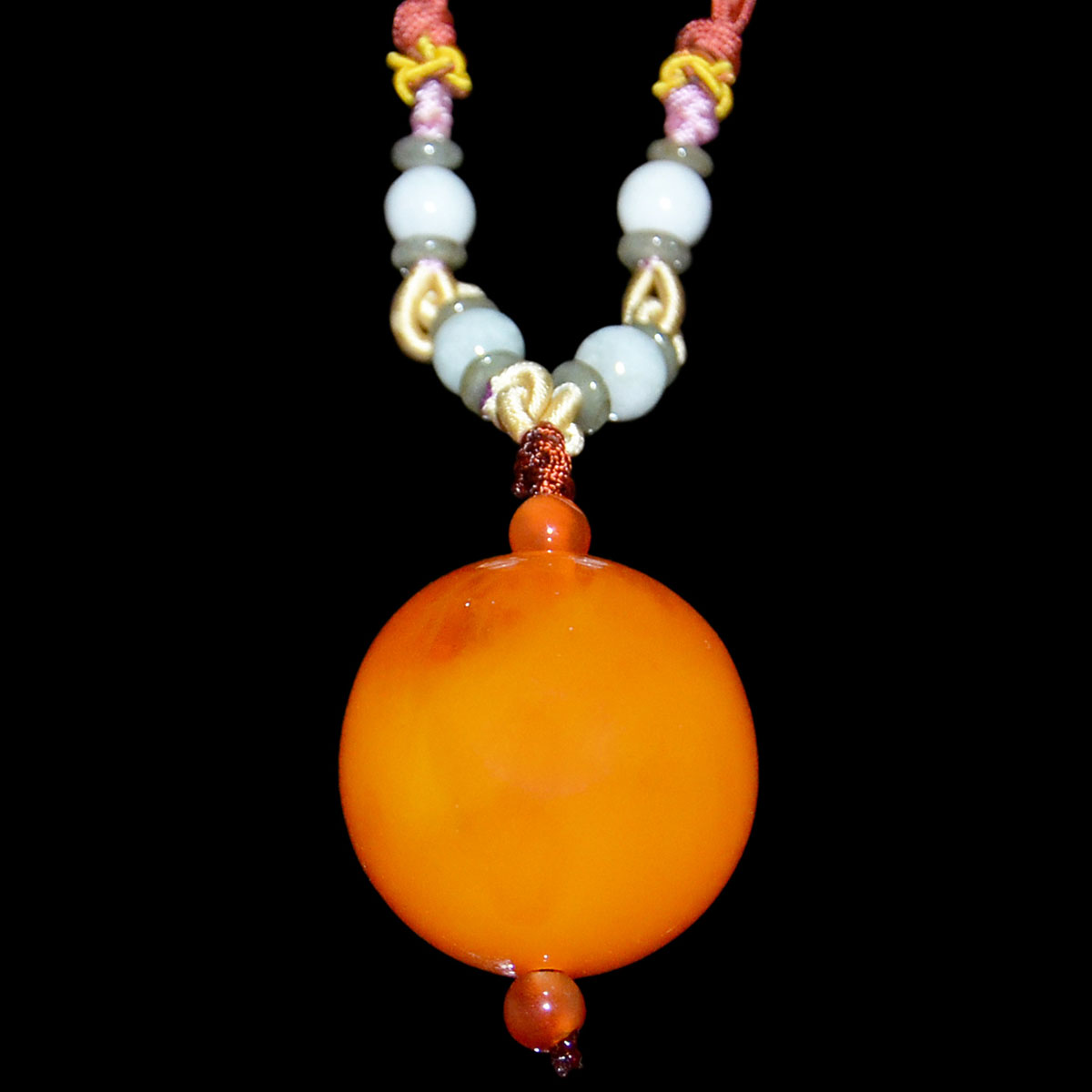 Lot 22 - 西藏-朝珠圓蜜蠟項飾連珠鏈 Tibetan Beeswax Amber Bead Pendant Necklace. Diameter: 1¼ in (3.2 cm)  Weight: 29 g.