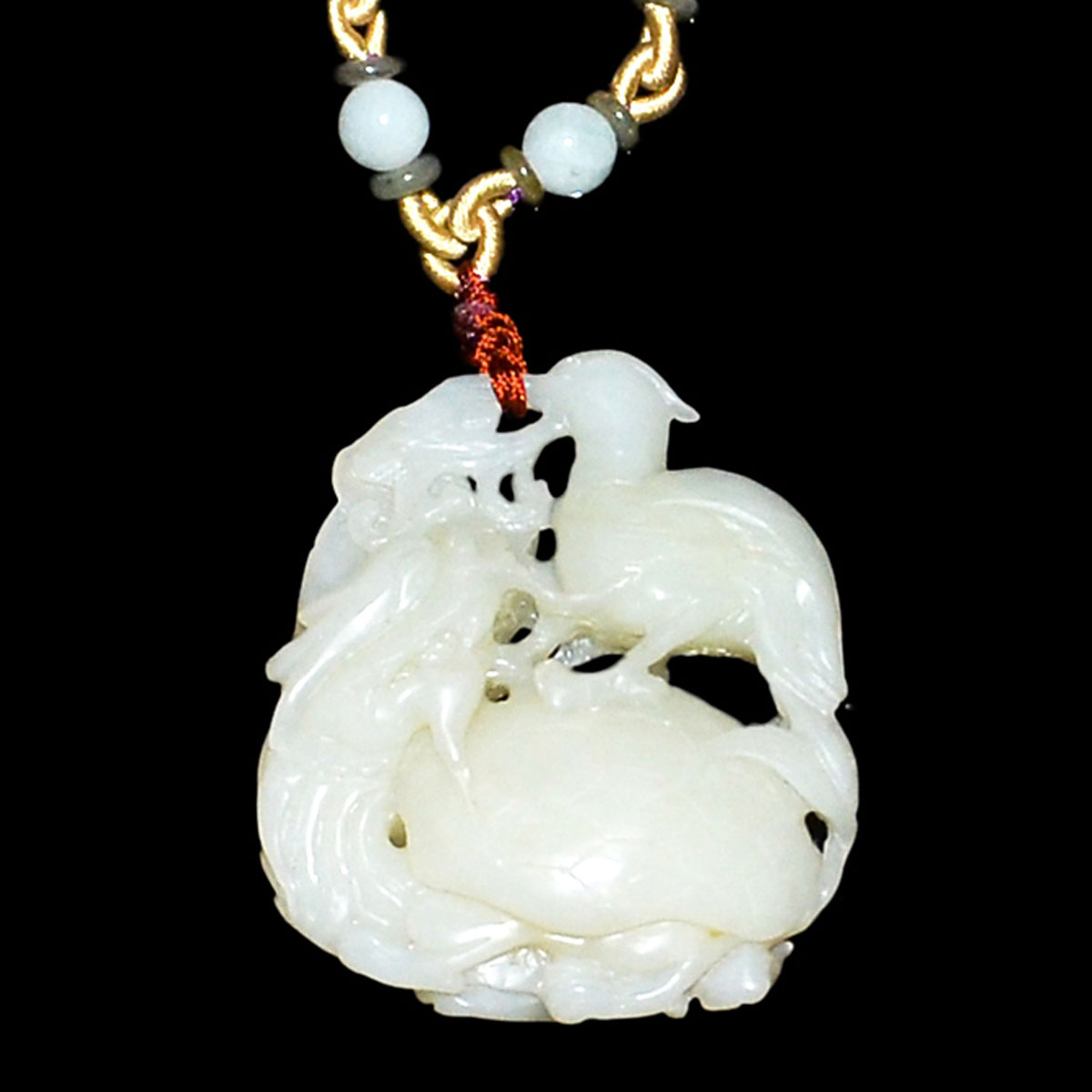 Lot 44 - 和田玉鏤雕龍龜背鳥掛飾連珠鏈 A Well Carved Hetian Jade Pendant and Necklace with Bird atop Dragon-Tortoise.