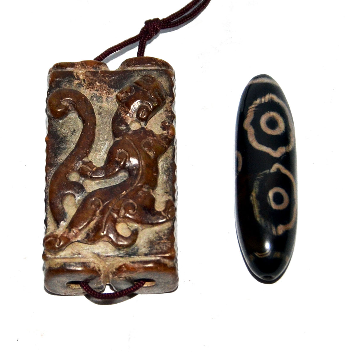 Lot 31 - 古掛飾兩件:小螭龍雙連玉琮,六眼天珠 A Small Archaistic Relief Carved Qilin Twin-linked Jade Cong Pendant & a