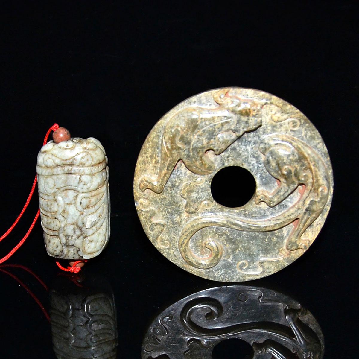 Lot 34 - 古玉掛飾兩件:螭龍璧,玉蟬 Two Archaistic Jade Pendants Carvings: Qilin Bi and Cicada. Diameter: 2⅝ in (6.7 cm)