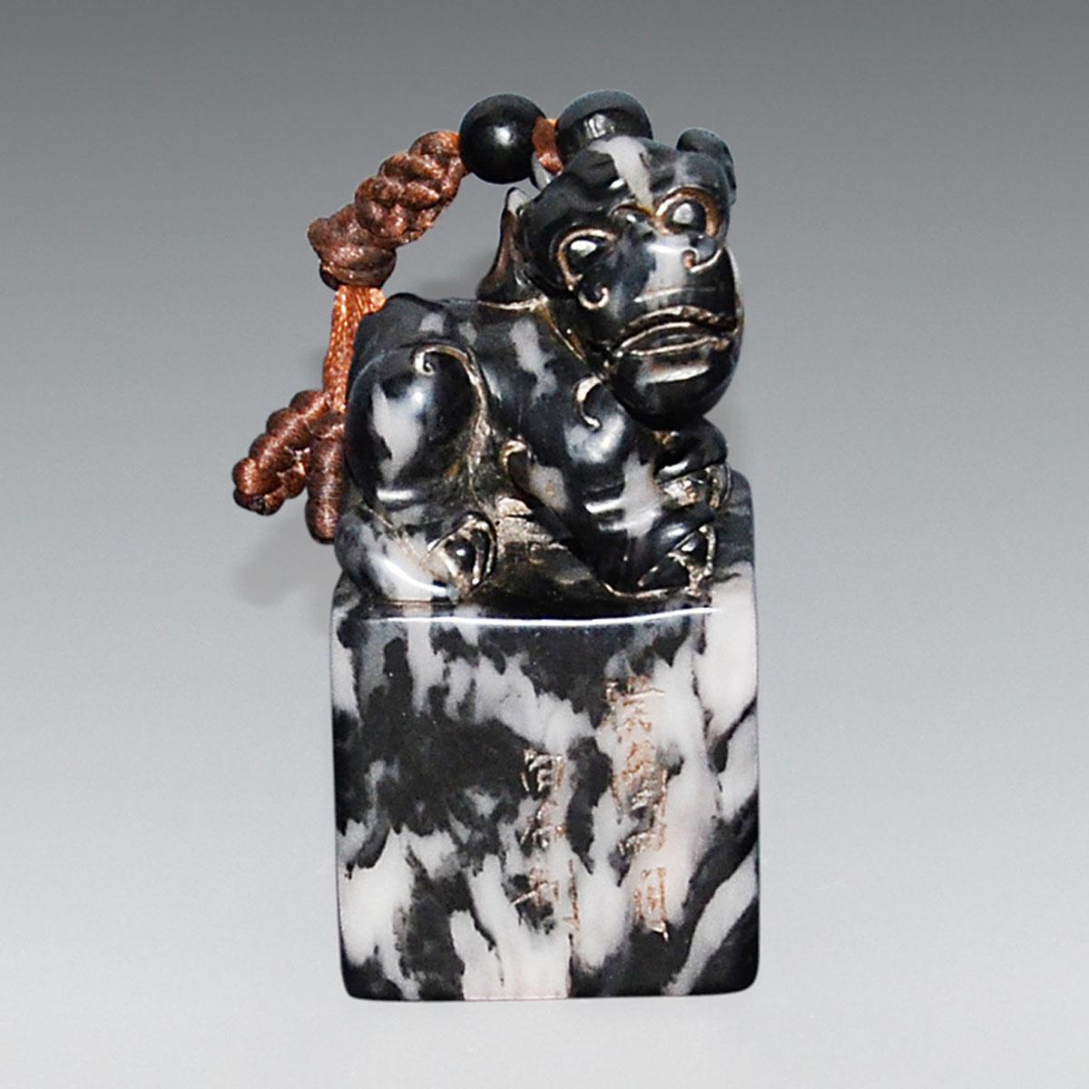 Lot 49 - 壽山石墨地辟邪印章 邊刻(癸酉四月白石刻) 印文(半牕雪月梅花) A Dark Shoushan Stone Seal with Carved Bixie As Knob. Height: 3