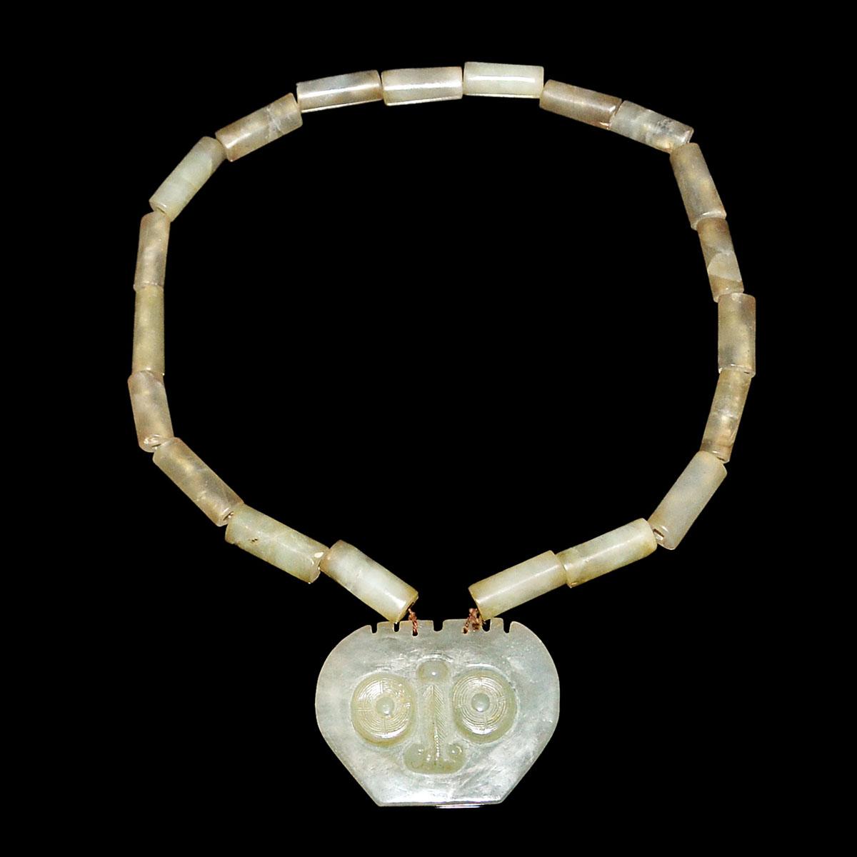Lot 17 - 玉雕圓筒珠鍊連饕餮紋掛墜 Jade Bead Necklace with Taotie Mask Pendant. Diameter: 7 in (17.8 cm)  Pendant