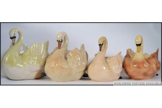 A Collection Of 4 Large Ceramic Swan Planters One Marked To