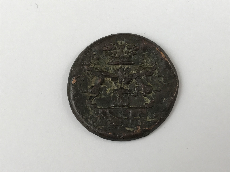 Lot 41 - A copper livery button, 17th / 18th Century