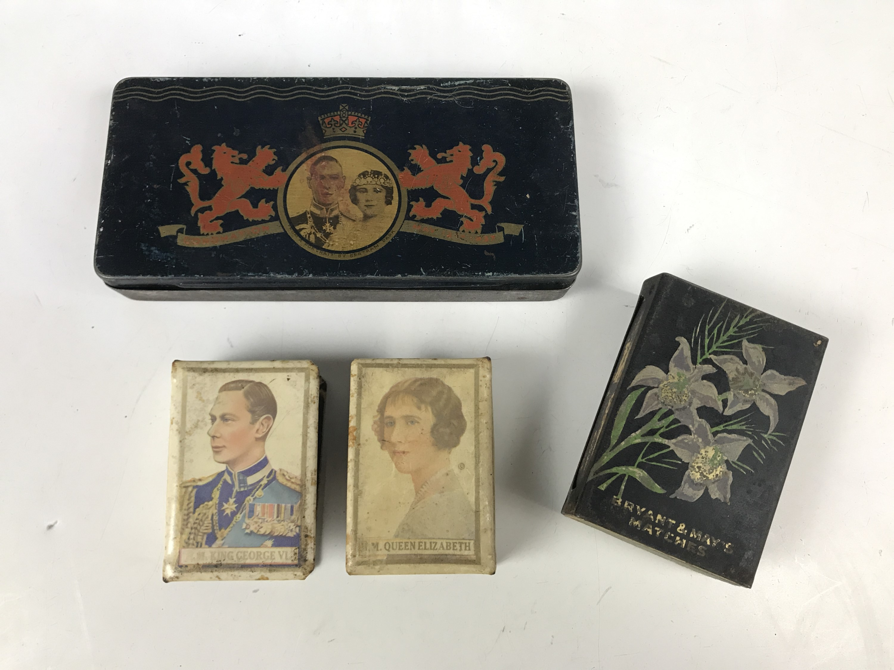 Lot 11 - A city of Carlisle royal commemorative coronation tin, together with two matchbox covers and one