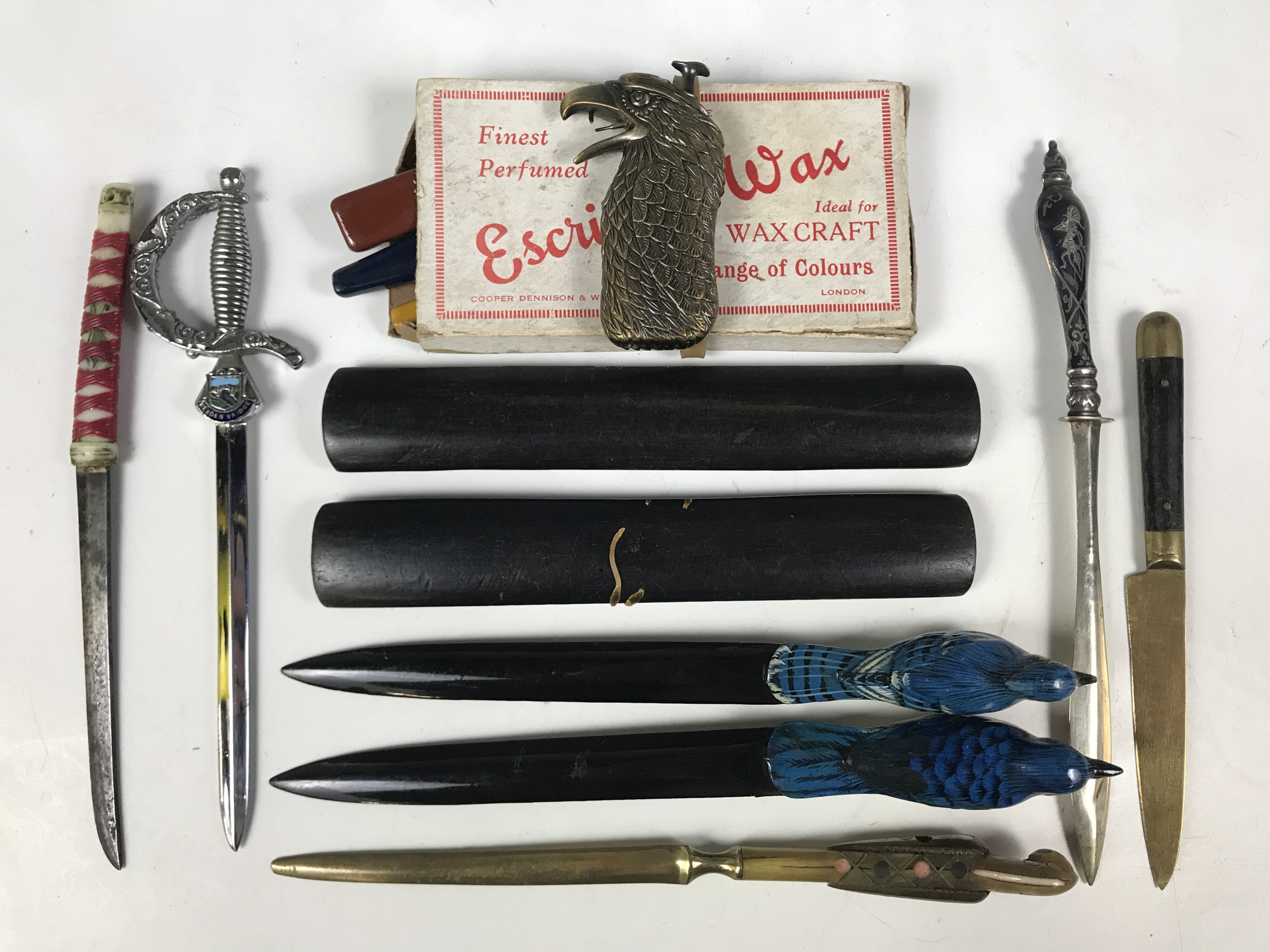 Lot 4 - A collection of paper / letter knives, boxed sealing wax, straight edges and a novelty lighter