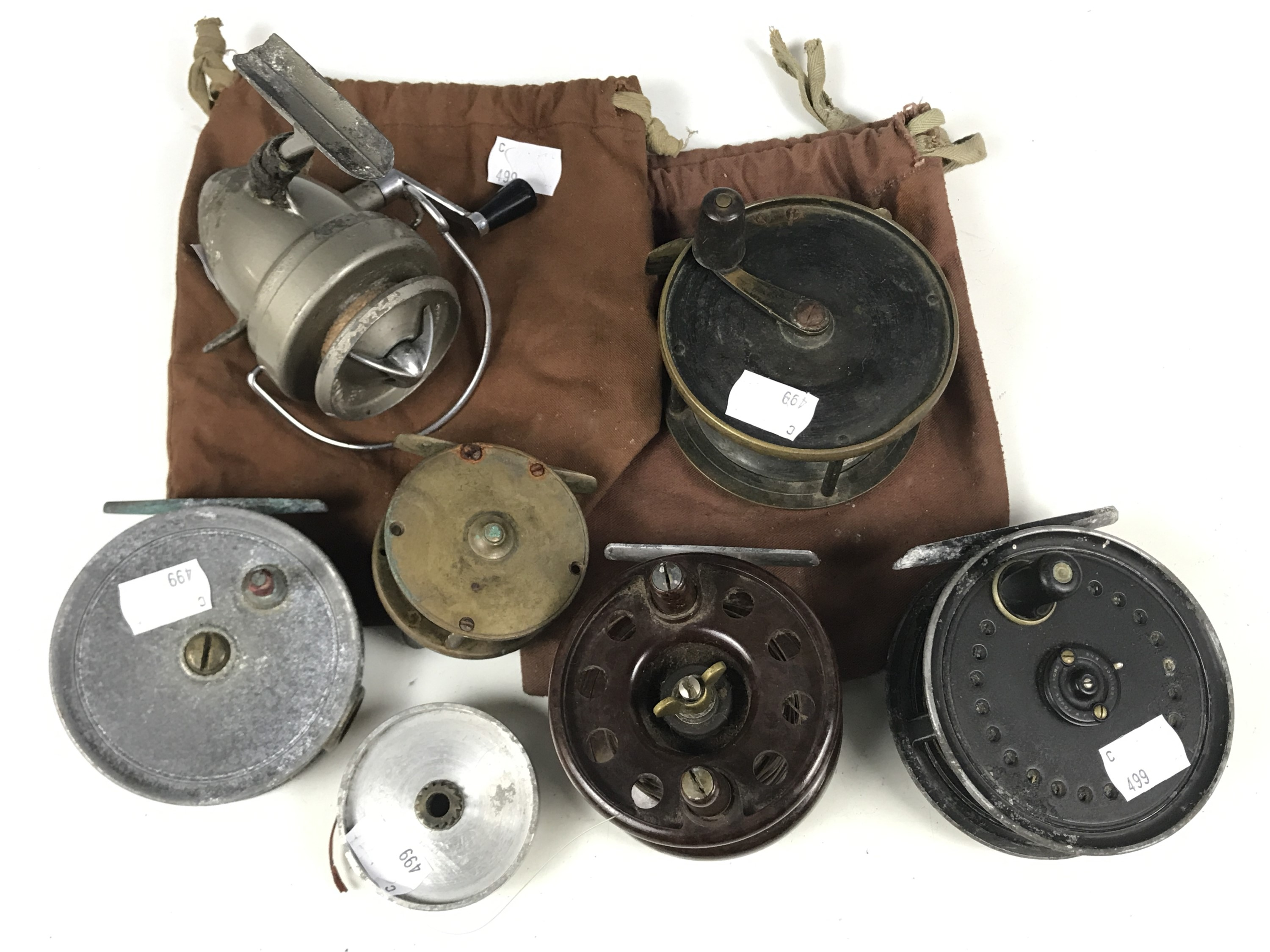 Lot 53 - Six various vintage fishing reels including Bakelite, Alex Martin, Young's Beaudex and Turnbull of