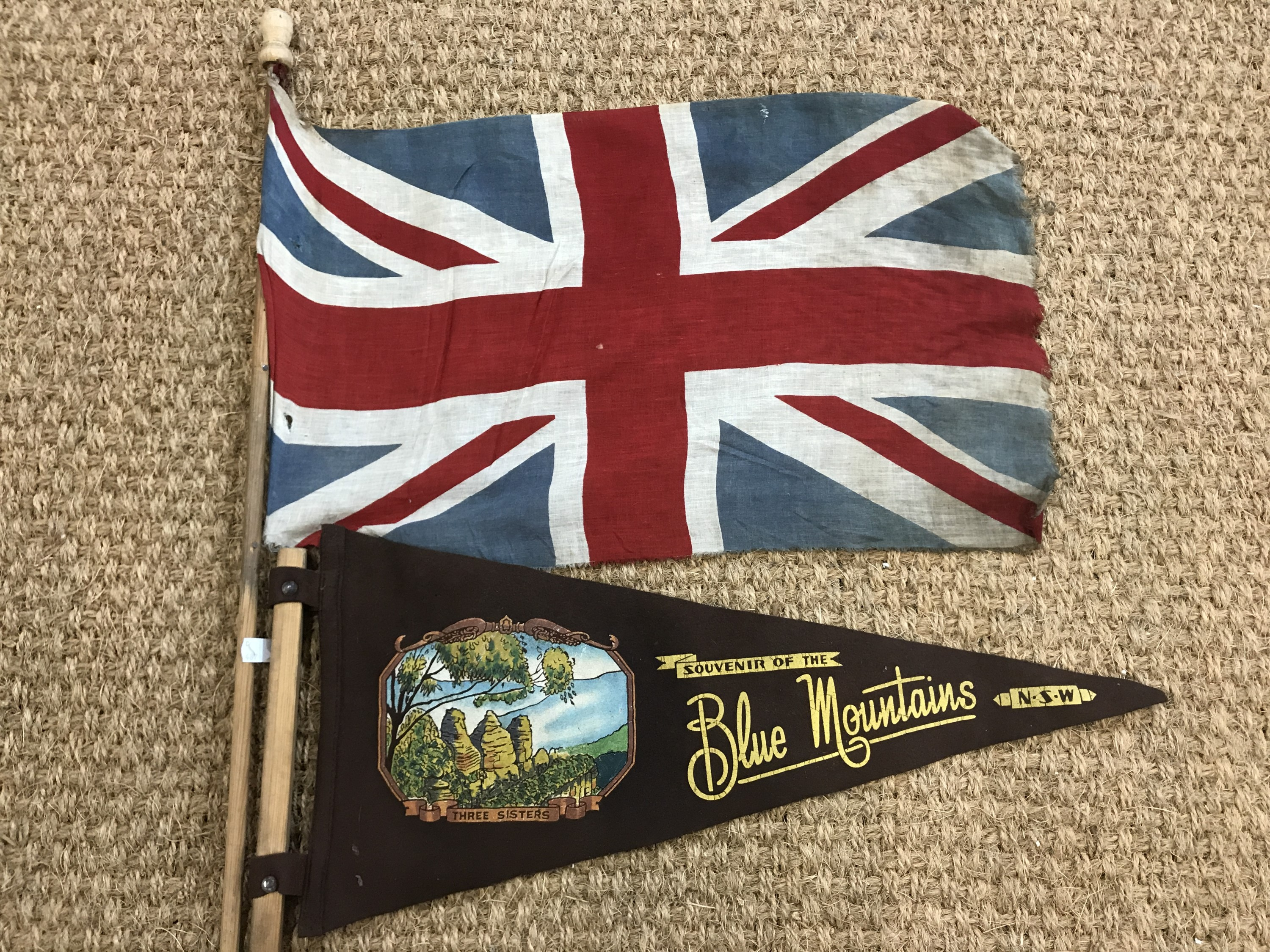 Lot 10 - A vintage Blue Mountains pennant together with a Union jack pennant