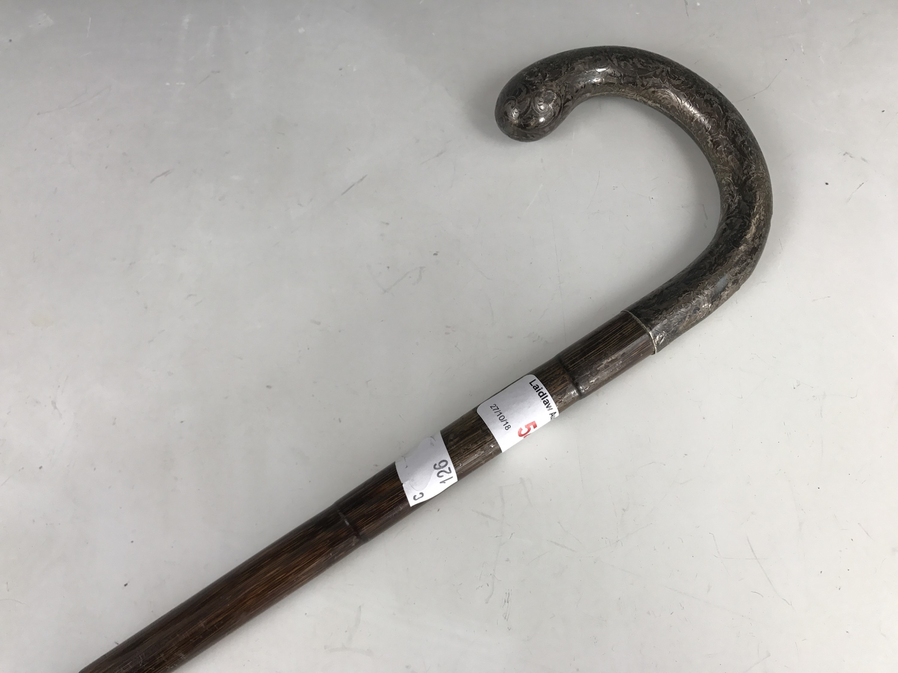 Lot 54 - An early 20th Century gentleman's silver handled walking cane, having foliate engraved decoration