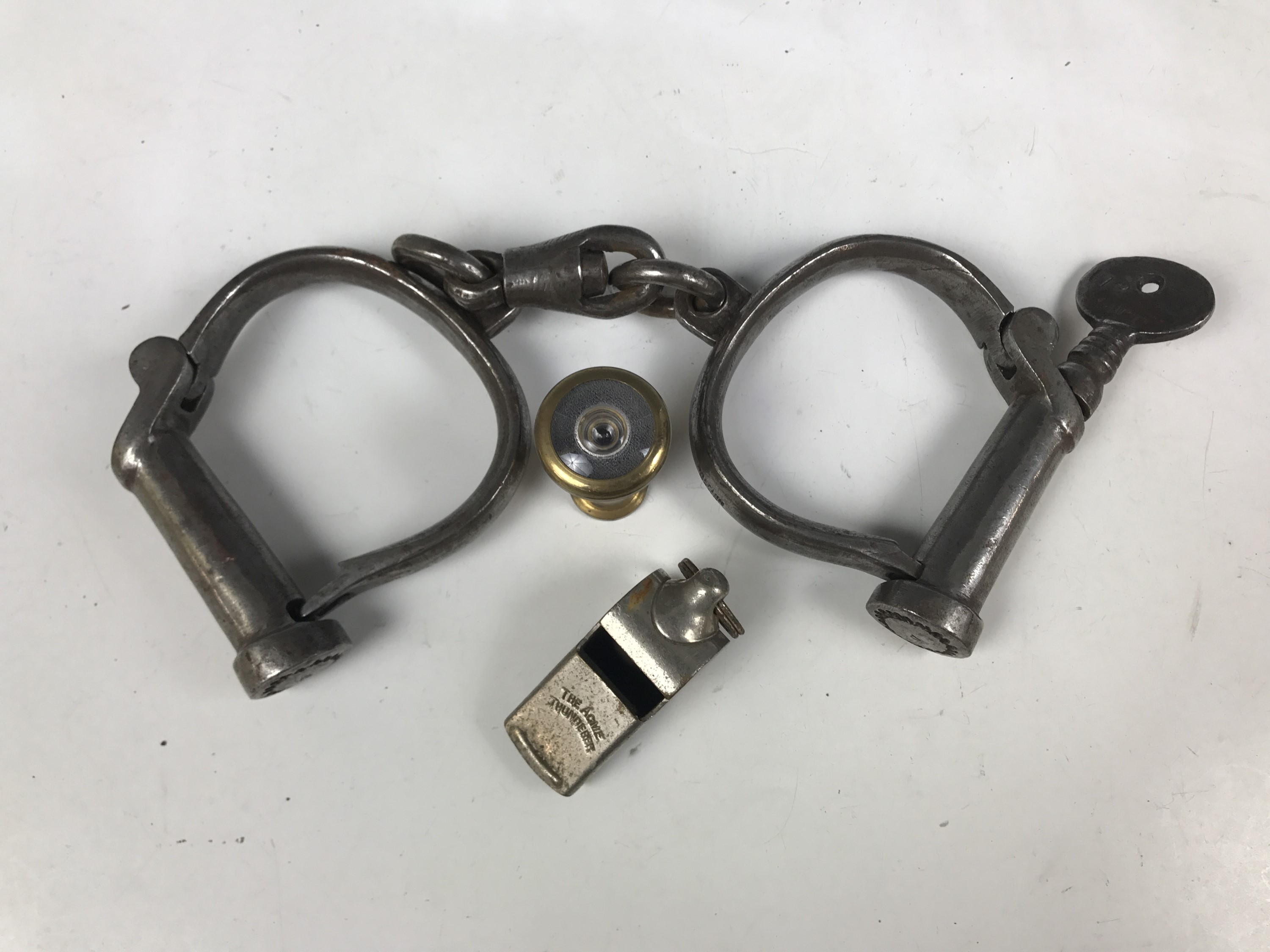 Lot 35 - A pair of late 19th / early 20th Century Wigtownshire Constabulary police handcuffs with key,