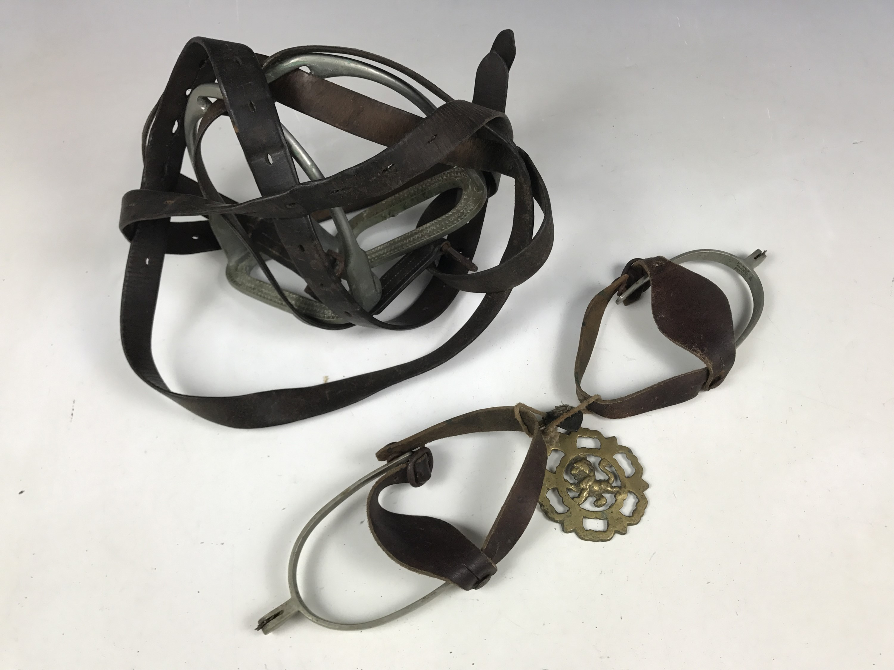 Lot 49 - A set of nickel riding stirrups, spurs and a horse brass