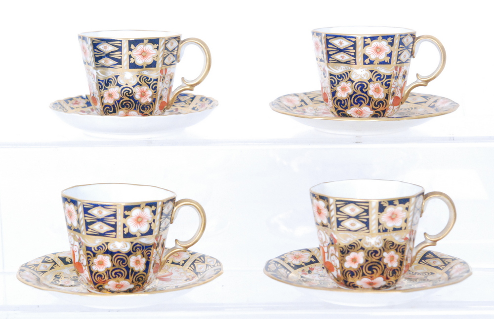 Lot 53 - Three Royal Crown Derby coffee cups and saucers decorated in the Imari 2451 pattern together with a