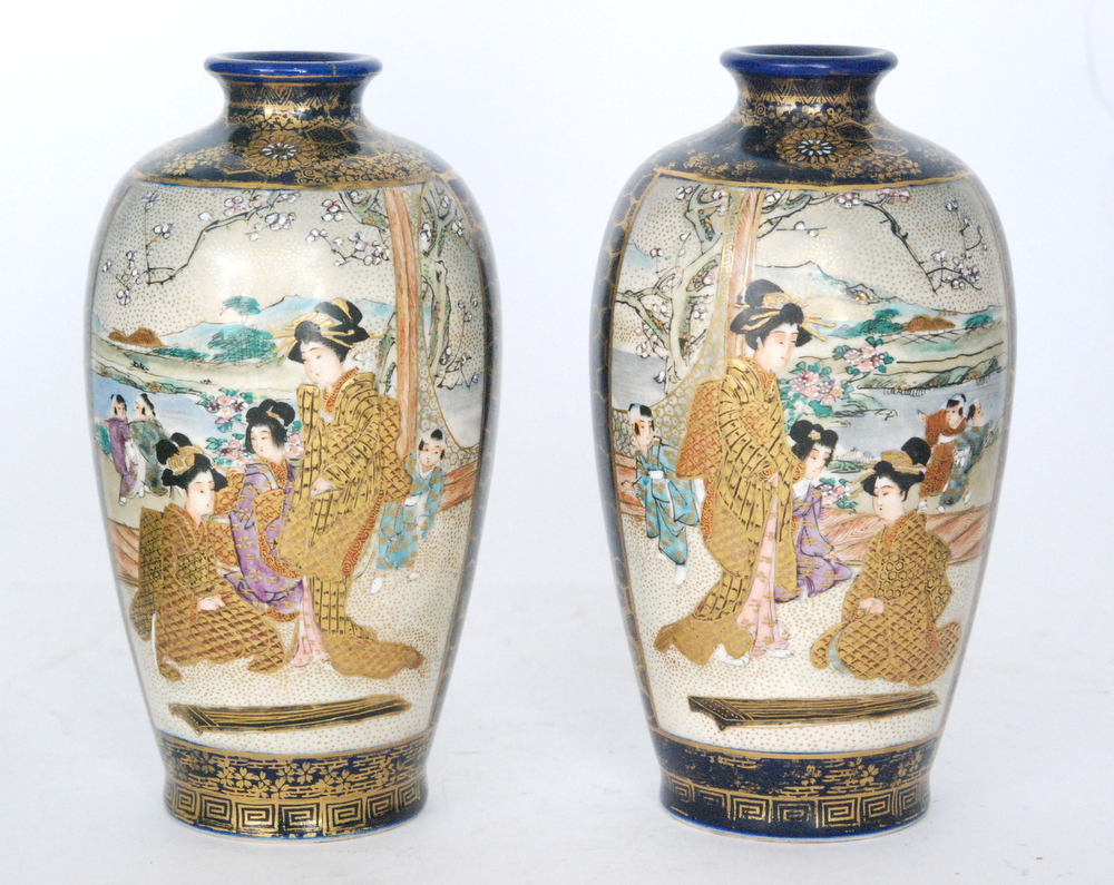 Lot 25 - A pair of late 19th to early 20th Century Japanese Satsuma vases each panel decorated with scenes