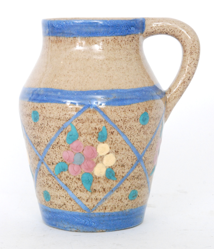 Lot 27 - A small Clarice Cliff Goldstone Abstract Lotus jug circa 1936 hand painted with stylised flower