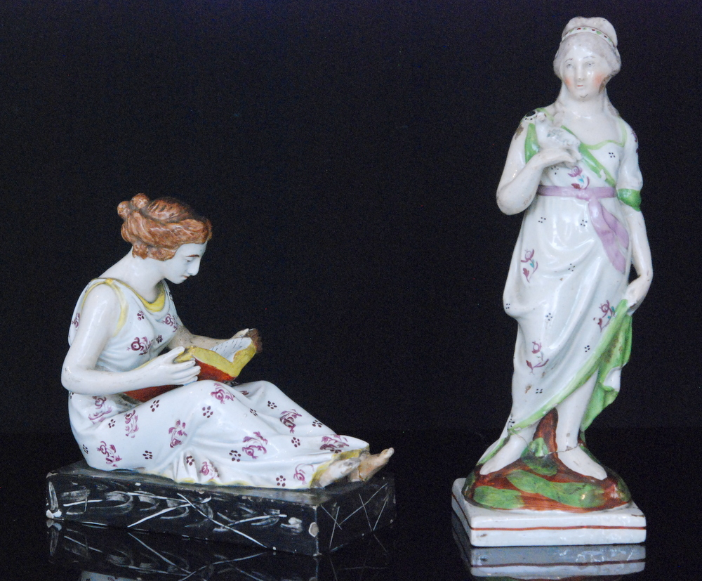 Lot 34 - Two 19th Century Staffordshire figures, the first modelled as a lady stood holding a dove,