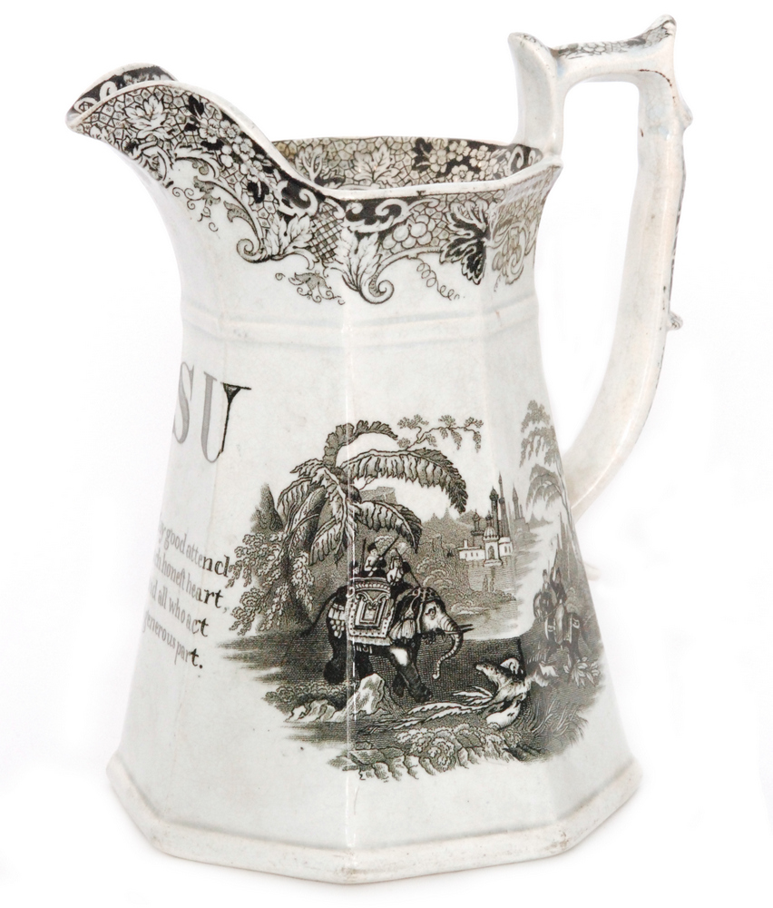 Lot 31 - A 19th Century Staffordshire puzzle jug decorated with a black and white applied transfer print