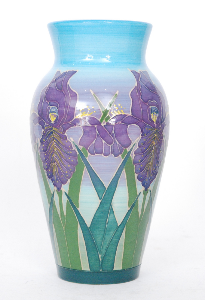 Lot 47 - A Dennis China Works vase decorated with tubelined purple iris against a tonal blue and purple