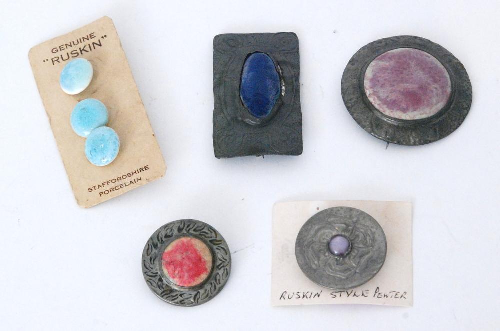 Lot 18 - A set of three Ruskin Pottery carded light blue souffle glaze buttons,